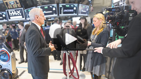 Bruce being interviewed at the New York Stock Exchange
